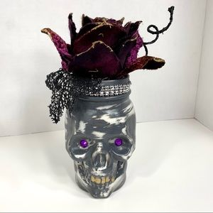 Halloween skull jar with faux velvet flower decor.